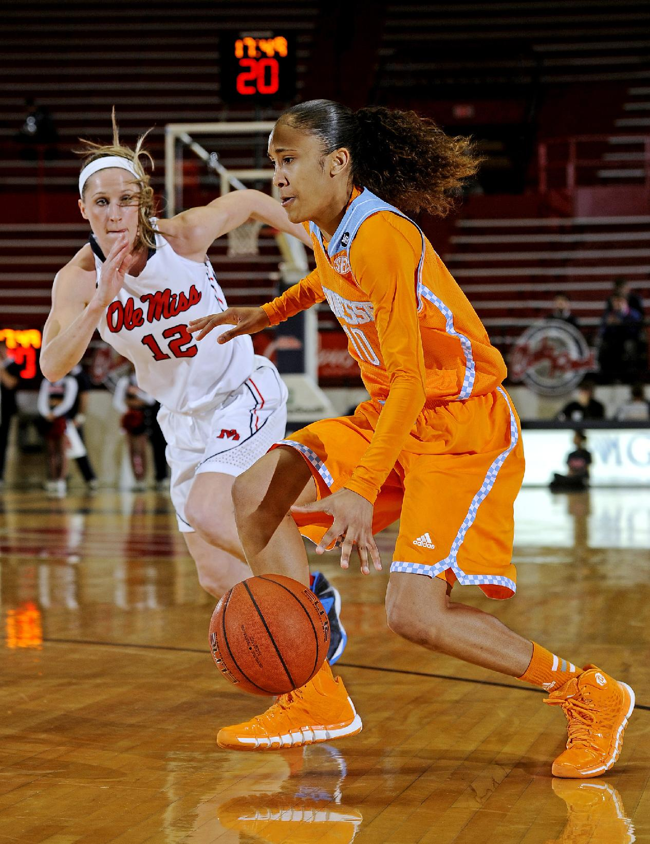 Tennessee guard Meighan Simmons (10) drives the ball past Mississippi guard Gracie Frizzell (12) during the first half of an NCAA college basketball game in Oxford, Miss., Thursday, Feb. 6, 2014