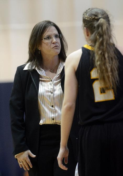 Appalachian State basketball coach Darcie Vincent talks with Farrahn Wood during an NCAA college basketball game against Chattanooga in Chattanooga, Tenn., on Saturday, Feb. 8, 2014