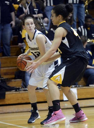 Chattanooga's Meghan Downes, left, looks to pass as Appalachian State's Amber Doniere defends during an NCAA college basketball game in Chattanooga, Tenn., on Saturday, Feb. 8, 2014