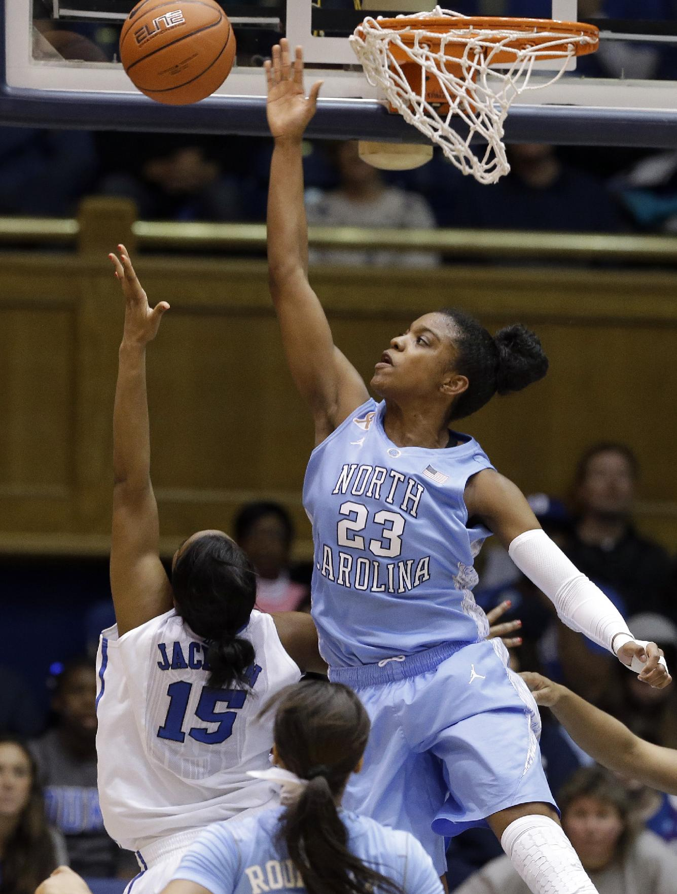 North Carolina's Diamond DeShields (23) blocks Duke's Richa Jackson (15) during the second half of an NCAA college basketball game in Durham, N.C., Monday, Feb. 10, 2014. North Carolina won 89-78