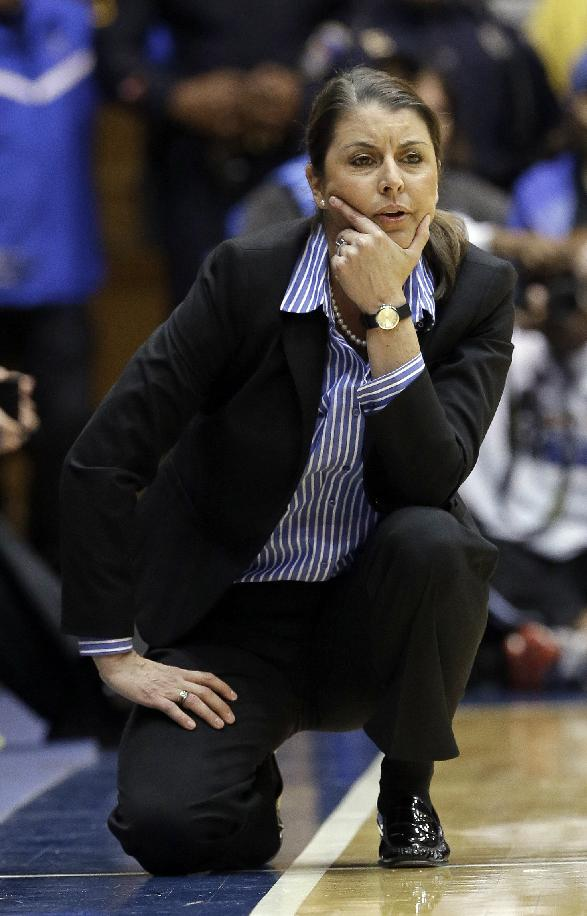 Duke coach Joanne P. McCallie watches her team during the second half of an NCAA college basketball game against North Carolina in Durham, N.C., Monday, Feb. 10, 2014. North Carolina won 89-78