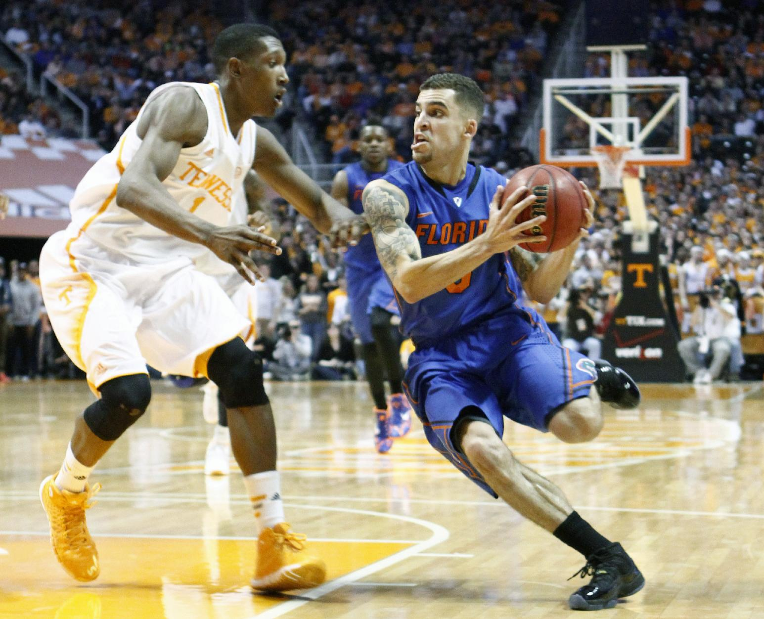 Florida guard Scottie Wilbekin, right, drives against Tennessee guard Josh Richardson, left, in the second half of an NCAA college basketball game, Tuesday, Feb. 11, 2014, in Knoxville, Tenn. Florida won 67-58