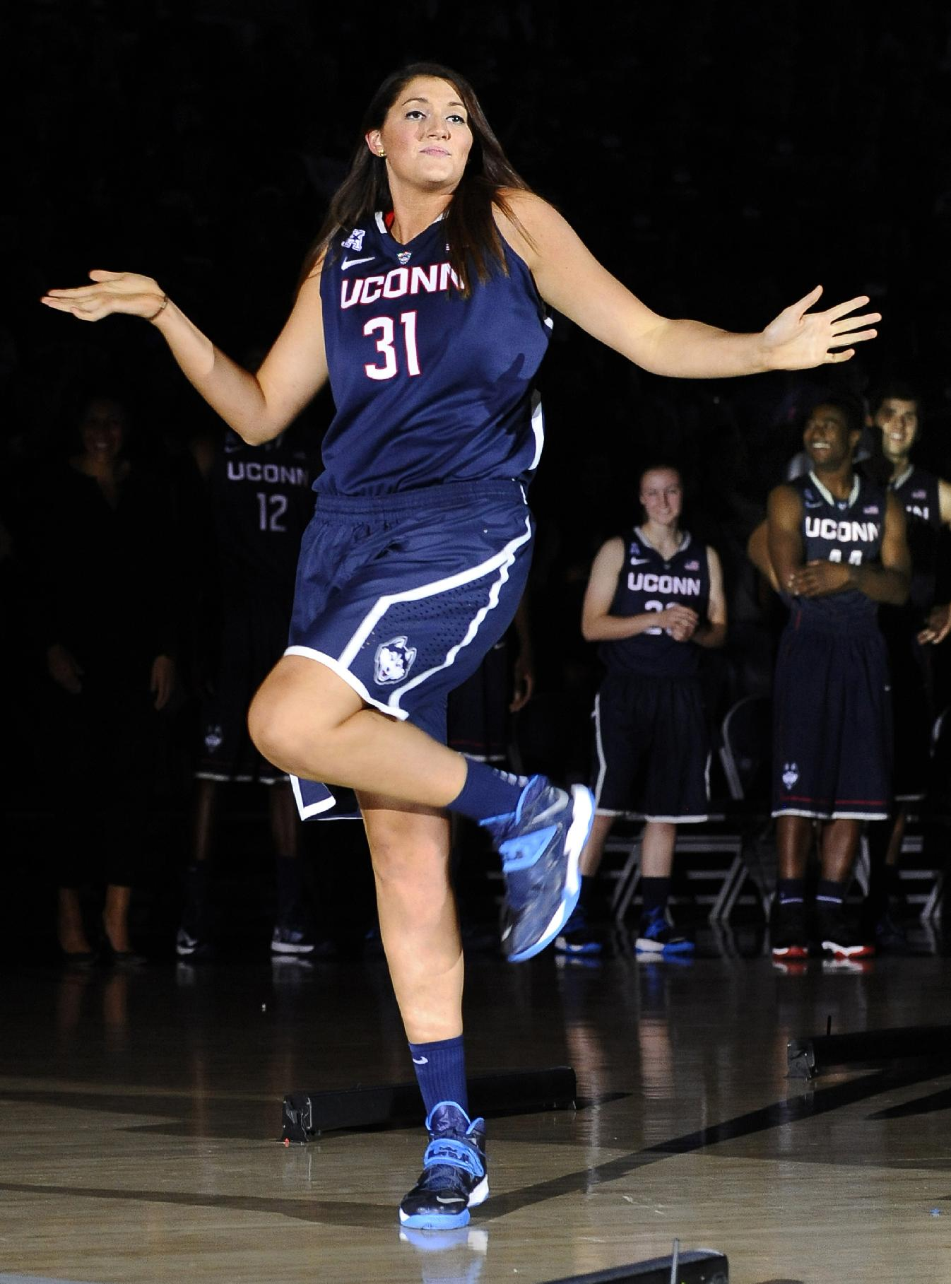 In this Oct. 18, 2013 file photo, Connecticut's Stefanie Dolson dances as she is introduced at the men's and women's basketball teams' First Night event in Storrs, Conn. On Saturday, March 1, 2014, Dolson and fellow senior Bria Hartley will have their names added to the