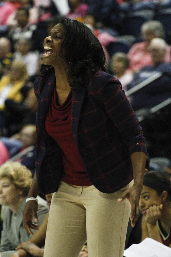 Elon head coach Charlotte Smith yells to her team during the first half of an NCAA college basketball game against Chattanooga, Friday, Feb. 28, 2014, in Chattanooga, Tenn