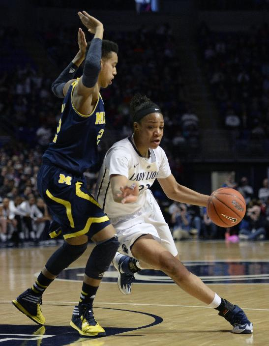 Penn State's Ariel Edwards (23) drives past Michigan's Cyesha Goree (22) in the first half of an NCAA college basketball game on Saturday, March 1, 2014, in State College, Pa