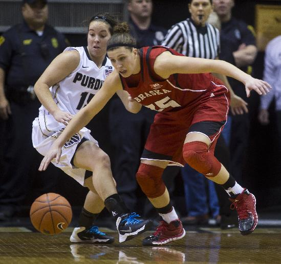 Purdue's Courtney Moses and Nebraska's Jordan Hooper go for a loose ball during an NCAA college basketball game Sunday, March 2, 2014, at Mackey Arena in West Lafayette, Ind. Purdue won 82-66
