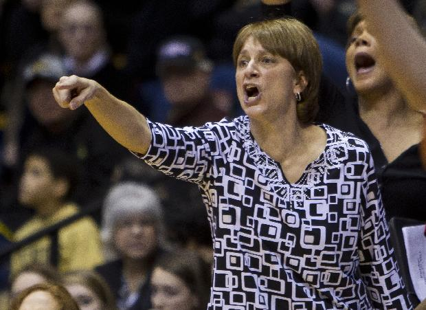 Nebraska coach Connie Yori calls out instructions to her team during an NCAA college basketball game against Purdue on Sunday, March 2, 2014, at Mackey Arena in West Lafayette, Ind. Purdue won 82-66