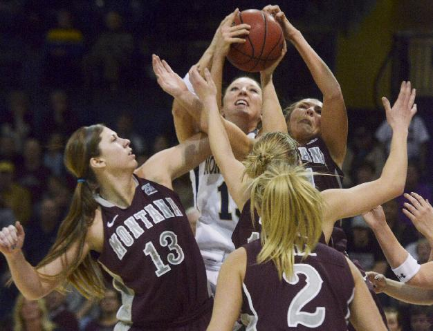 Montana State University forward Kayla DeWit, center,  battles for a rebound against University of Montana defenders Alycia Sims (13) and Jordan Sullivan during the Big Sky Conference NCAA basketball game at Brick Breeden field house Monday evenin, March 3, 2014, inBozeman, Mont