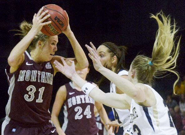 University of Montana forward Jordan Sullivan(31) gets swarmed by Montana State University defenders Ashley Brumwell and Jasmine Hommes during their Big Sky Conference NCAA basketball game Monday evening, March 3, 2014,  in Bozeman, Mont