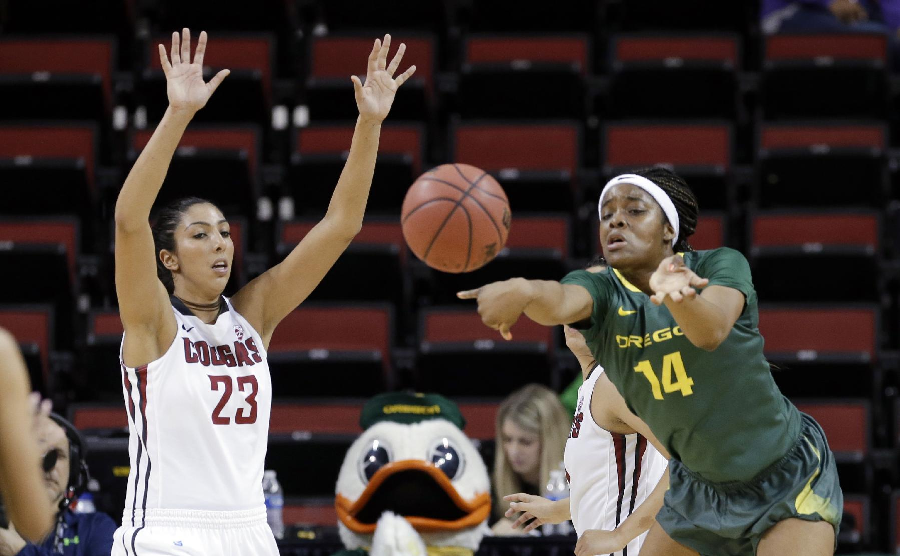 Oregon's Jillian Alleyne (14) passes in front of Washington State's Shalie Dheensaw during the second half of an NCAA college basketball game in the Pac-12 women's tournament Thursday, March 6, 2014, in Seattle. Washington State won 107-100