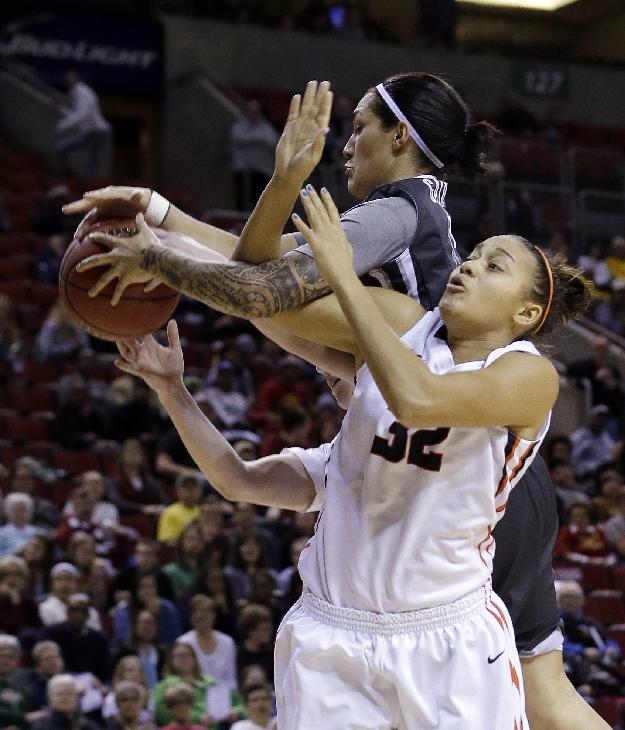 Washington State's Lia Galdeira, left, and Oregon State's Deven Hunter vie for a rebound in the first half of an NCAA college basketball game in the Pac-12 women's tournament Saturday, March 8, 2014, in Seattle