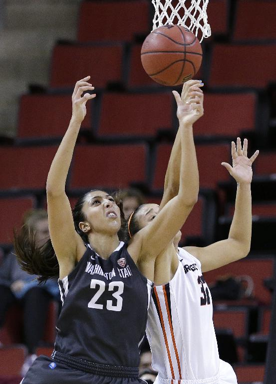 Washington State's Shalie Dheensaw (23) and Oregon State's Deven Hunter reach for a loose ball in the first half of an NCAA college basketball game in the Pac-12 women's tournament Saturday, March 8, 2014, in Seattle