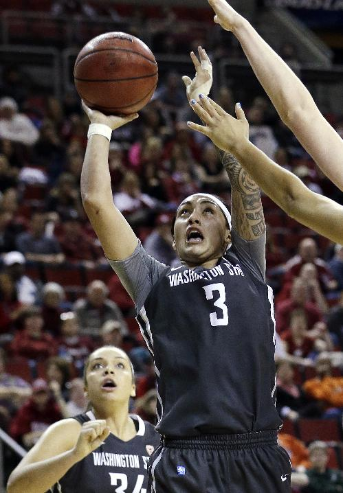 Washington State's Lia Galdeira shoots against Oregon State in the second half of an NCAA college basketball game in the Pac-12 women's tournament  Saturday, March 8, 2014, in Seattle. Oregon State won 70-60