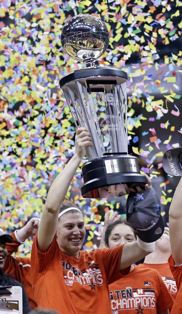 Nebraska forward Jordan Hooper hoist the championship trophy after defeating Iowa in an NCAA college basketball game in the finals of the Big Ten women's tournament in Indianapolis, Sunday, March 9, 2014. Nebraska won 72-65