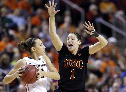 Oregon State's Gabriella Hanson, left, looks for room to pass around the defense of Southern California's Jordan Adams in the second half of the Pac-12 NCAA college championship basketball game Sunday, March 9, 2014, in Seattle.  USC won 71-62