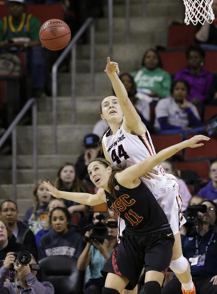 Southern California's Cassie Harberts (11) and Oregon State's Ruth Hamblin eye a loose ball in the second half of the Pac-12 NCAA college championship basketball game Sunday, March 9, 2014, in Seattle.  USC won 71-62