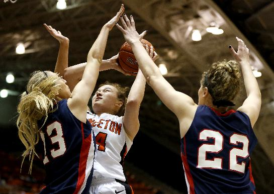 Princeton guard Michelle Miller (34) goes up for a shot against Penn center Sydney Stipanovich (13) and forward Kara Bonenberger (22) during the second half of an NCAA college basketball game, Tuesday, March 11, 2014, in Princeton, N.J. Penn won 80-64
