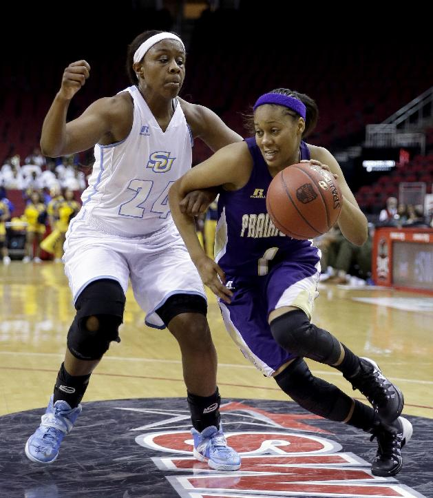 Prairie View A&M's Jeanette Jackson (1) drives around Southern's Adrian Sanders (24) during the second half of an NCCA college basketball game in the semifinals of the Southwestern Athletic Conference tournament Friday, March 14, 2014, in Houston. Prairie View A&M won 72-43