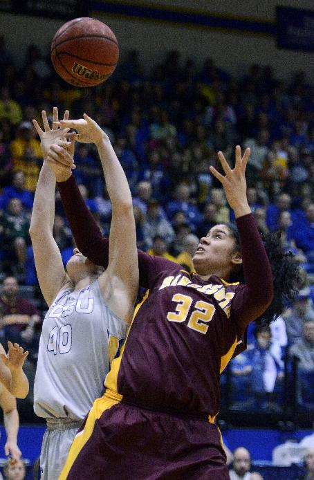 South Dakota State's Mariah Clarin and Minnesota's Amanda Zahui grab for a rebound in the third round WNIT basketball game at Frost Arena in Brookings, S.D., Thursday, March 27, 2014