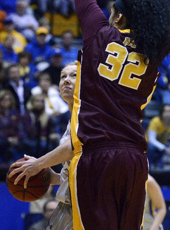 South Dakota State's Mariah Clarin eyes the net under Minnesota's Amanda Zahui in the third round WNIT basketball game at Frost Arena in Brookings, S.D., Thursday, March 27, 2014
