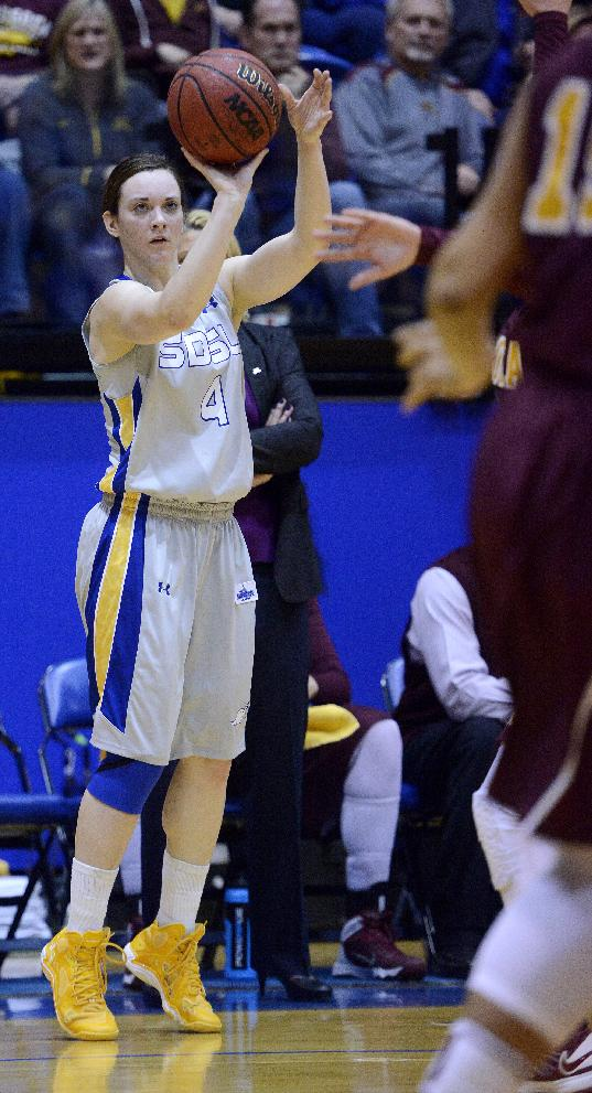 South Dakota State's Gabrielle Boever shoots for three as they play Minnesota in Thursday's 3rd round WNIT basketball game at Frost Arena in Brookings, S.D. March 27, 2014. SDSU beat Minnesota 70-62