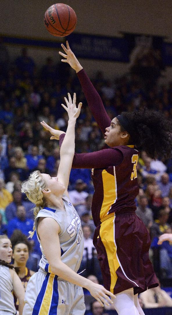 Minnesota's Amanda Zahui takes a shot over South Dakota State's Mariah Clarin in Thursday's 3rd round WNIT basketball game at Frost Arena in Brookings, S.D. March 27, 2014. SDSU beat Minnesota 70-62