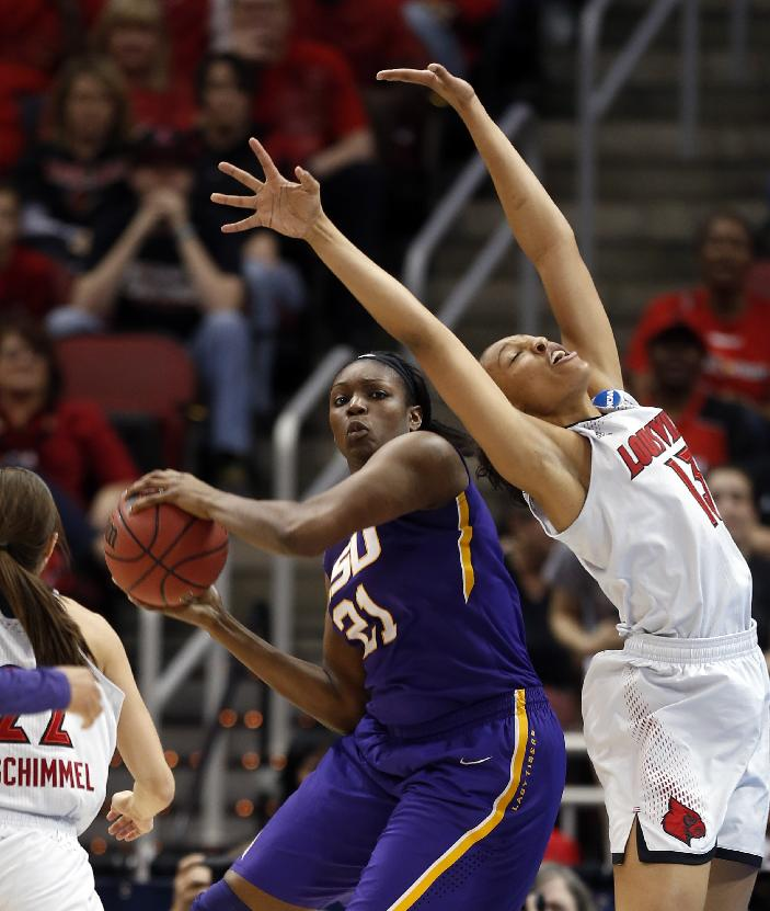LSU forward Ann Jones (31) and Louisville forward Cortnee Walton (13) battle for a rebound during the first half of a regional semifinal game at the NCAA college basketball tournament on Sunday, March 30, 2014, in Louisville, Ky