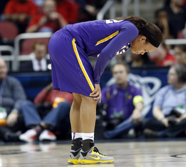 LSU guard Danielle Ballard (32) reacts during the first half of a regional semifinal game against Louisville at the NCAA college basketball tournament on Sunday, March 30, 2014, in Louisville, Ky