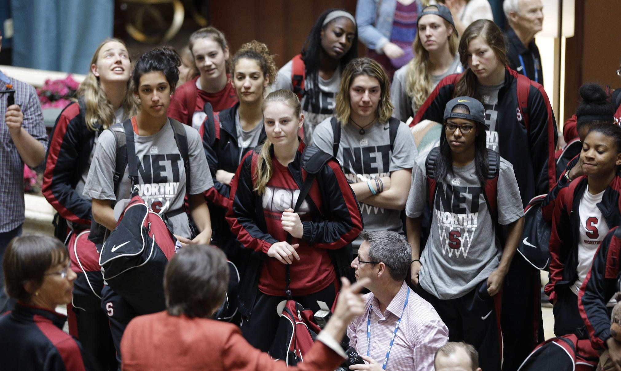 Stanford players listen as they are greeted upon their arrival at the team hotel Thursday, April 3, 2014, in Nashville, Tenn. Stanford is scheduled to play Connecticut in a semifinal of the NCAA women's college basketball Final Four on Sunday
