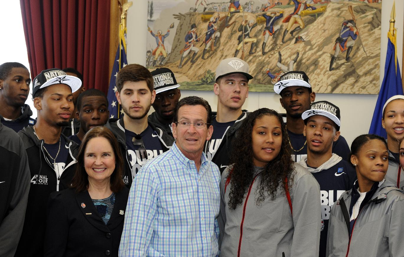 Members of Connecticut's men's and women's basketball teams gather with Connecticut Gov. Dannel P. Malloy in his office, Sunday, April 13, 2014, in Hartford, Conn. Both teams won the NCAA championship