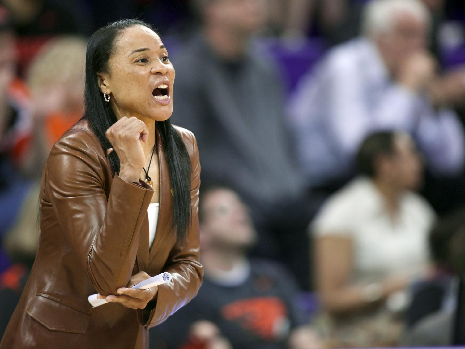 In this March 25, 2014, file photo, South Carolina head coach Dawn Staley yells to her team during the first half of a second-round game against Oregon State in the NCAA women's college basketball tournament in Seattle. After a landmark season that saw the Gamecocks earn win the Southeastern Conference regular-season title and earn a No. 1 seed in the NCAA tournament,  Staley landed the country's top college prospect in A'ja Wilson, setting off championship dreams among the fans who've gotten on board with the rising program