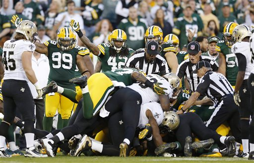 Players scramble after the fourth-quarter Darren Sproles fumble. (AP)