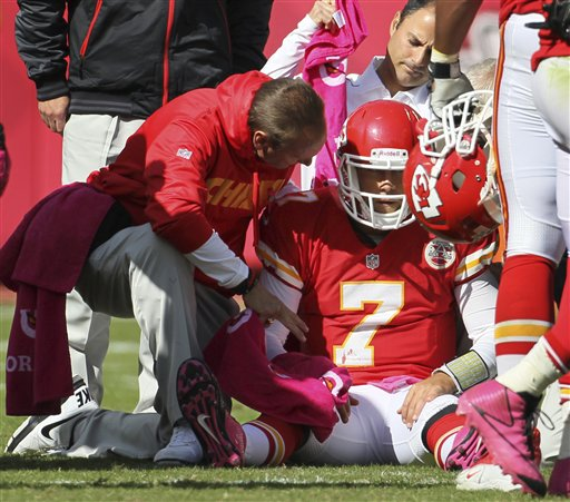 Trainers assist Matt Cassel during the second half of Sunday's game. (AP)
