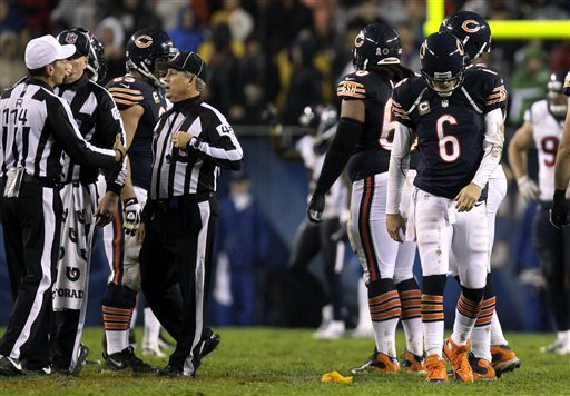 Jay Cutler (6) walks off the field after taking a hit by Texans LB Tim Dobbins in the second quarter. (AP)