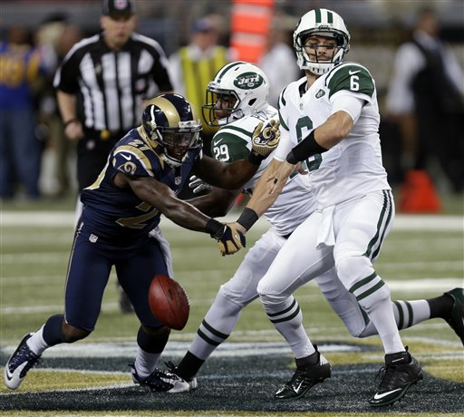 Despite eight Mark Sanchez fumbles, the Jets are still in the playoff hunt. (AP)