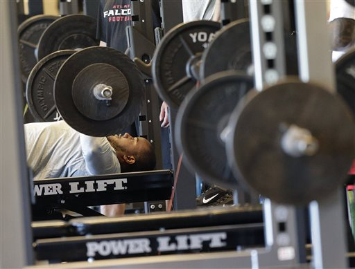 Atlanta Falcons linebacker Robert James lifts weights at their NFL football training complex, Tuesday, April 23, 2013, in Flowery Branch, Ga