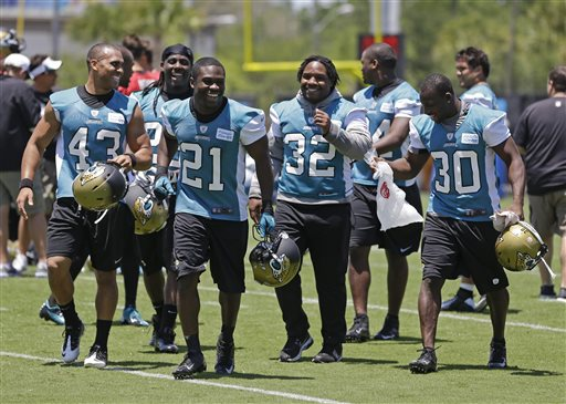 Jacksonville Jaguars players including, Jonathan Grimes (43), Justin Forsett (21), Maurice Jones-Drew (32) and Jordan Todman (30) leave the field after NFL football organized team activities, Monday, May 13, 2013, in Jacksonville, Fla