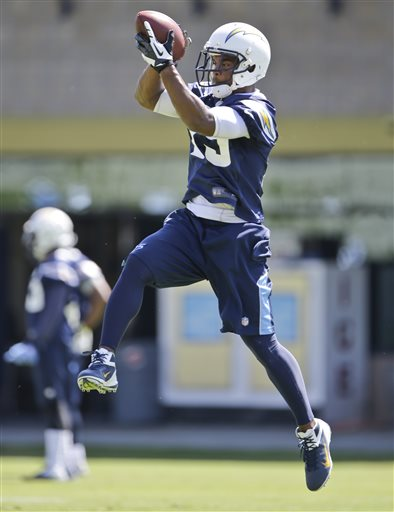 San Diego Chargers defensive back Darrell Stuckey leaps for a pass during drills at the teams' OTA's in San Diego, Monday, May 13, 2013