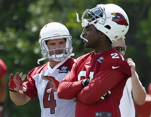 Arizona Cardinals' Jay Feely, left, talks with Patrick Peterson during punt drills during practice at the Cardinals training facility on Tuesday, May 14, 2013, in Tempe, Ariz