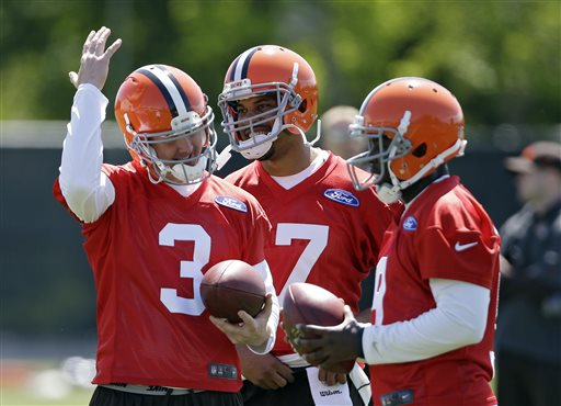 Cleveland Browns quarterback Brandon Weeden (3) jokes with Jason Campbell, center, and Thad Lewis during an off-season workout at the NFL football team's practice facility in Berea, Ohio Thursday, May 16, 2013