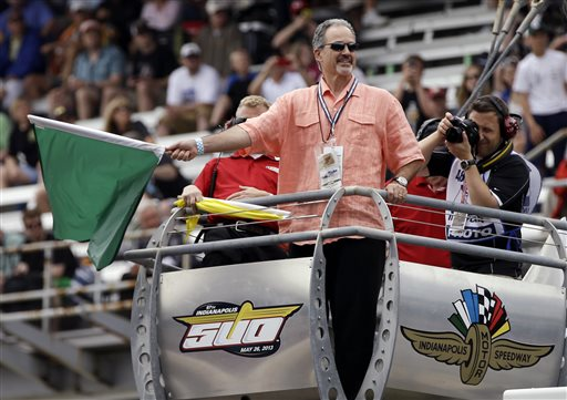 Indianapolis Colts head coach Chuck Pagano waves the green flag to begin qualifications on the first day of qualifications for the Indianapolis 500 auto race at the Indianapolis Motor Speedway in Indianapolis, Saturday, May 18, 2013
