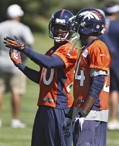 Denver Broncos safety Mike Adams, left, talks to cornerback Champ Bailey during off season training camp at the NFL football team's training facility in Englewood, Colo., on Monday, May 10, 2013