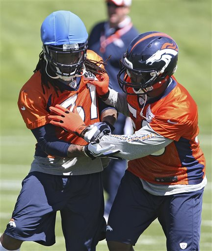 Denver Broncos cornerback Omar Bolden, left, and linebacker Von Miller workout during drills at off season training camp at the NFL football team's training facility in Englewood, Colo., on Monday, May 10, 2013