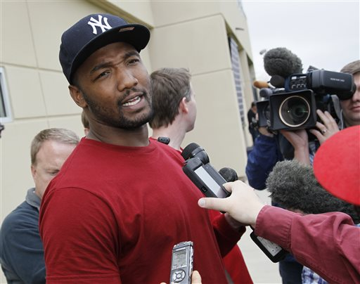 Denver Broncos linebacker Shaun Phillips talks to reporters after taking part in an off-season training camp at the NFL football team's training headquarters in Englewood, Colo., on Monday, May 20, 2013