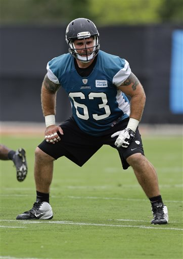 Jacksonville Jaguars center Brad Meester (63) runs through a drill during NFL football organized training activities, Monday, May 20, 2013, in Jacksonville, Fla