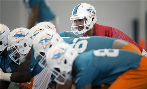 Miami Dolphins quarterback Matt Moore runs drills during NFL football training camp in Davie, Fla. Tuesday, May 21, 2013