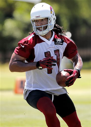 Arizona Cardinals' Larry Fitzgerald runs drills  during the team's NFL football organized team activities Tuesday, May 21, 2013, in Tempe, Ariz