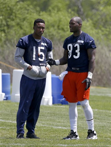 Chicago Bears wide receiver Brandon Marshall (15), rehabbing from off-season hip surgery, talks with tight end Martellus Bennett during the Bears' NFL football practice in Lake Forest, Ill., Tuesday, May 21, 2013