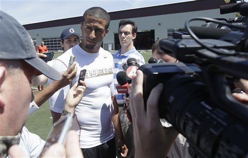 San Francisco 49ers quarterback Colin Kaepernick  speaks to reporters after practice at an NFL football training camp in Santa Clara, Calif., Wednesday, May 22, 2013