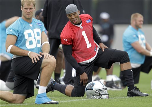 Carolina Panthers' Cam Newton (1) and Greg Olsen (88) stretch before NFL football team practice in Charlotte, N.C., Thursday, May 23,2013